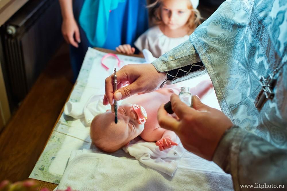 крестины ребенка фотограф